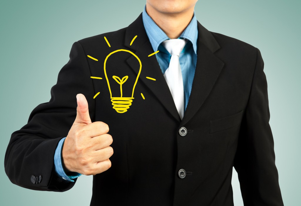 businessman giving you thumbs up lightbulb idea concept